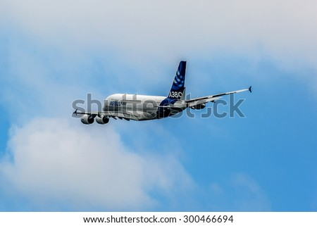PARIS, FRANCE - JUNE 20, 2015: The Airbus A380, the largest passenger airliner in the world, does a demonstration flight at 51st International Paris Salon (Le Bourget). - stock photo