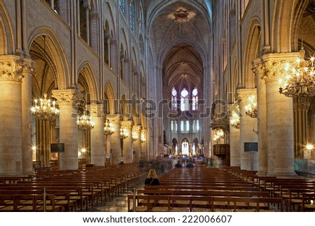 PARIS, FRANCE - JUNE 6, 2011: The nave of Notre Dame gothic cahedral.