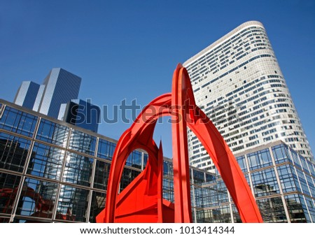 PARIS, FRANCE - JUNE 18, 2011: The skyscrapers and the moder red metal sculpture.