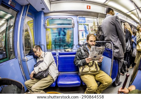 PARIS , FRANCE- JUNE 10, 2015: Tourists and locals on a subway train Line 8 in Paris, France. More than 30 million people visit Paris annually. - stock photo