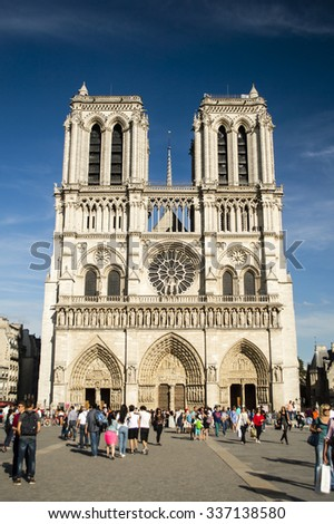 PARIS, FRANCE - JUNE 6: Tourists gather in front of Notre-Dame de Paris Cathedral on June 6, 2015. - stock photo