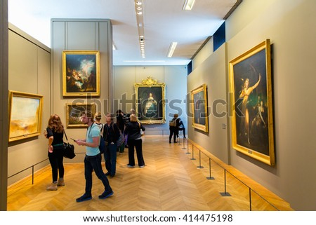 PARIS, FRANCE - JUNE 1,2015: Tourists visit Louvre Museum in Paris, France. With 8.5m annual visitors, Louvre is consistently the most visited museum worldwide.