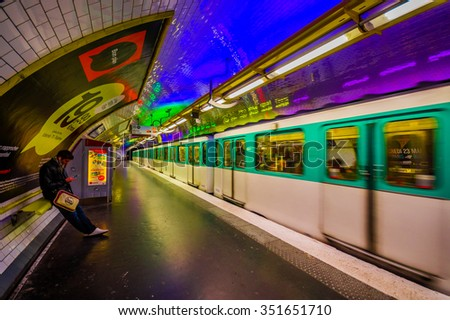 PARIS, FRANCE - JUNE 1, 2015: Train moving rapidly in a station of the parisian subway, Paris Metro or Metropolitain - stock photo