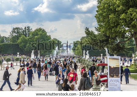 PARIS, FRANCE - JUNE 13, 2012: Tuileries garden is a favorite spot for rest of tourists and Parisians. Tuileries is a public garden located between the Louvre Museum and the Place de la Concorde.