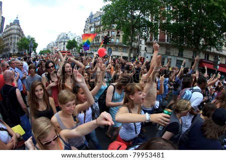 PARIS, FRANCE - JUNE 25. Unidentified people took part in the Paris Gay Pride parade to support the LGBT (lesbian, gay, bisexual, and transgender) rights, on June 25, 2011 in Paris, France. - stock photo