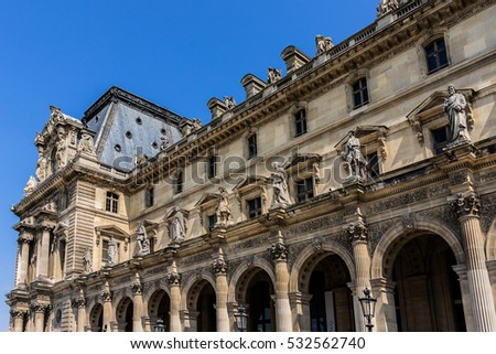PARIS, FRANCE - JUNE 9, 2015: View ancient sculpture in the courtyard of Louvre Museum. Louvre Museum is one of the largest and most visited museums worldwide.