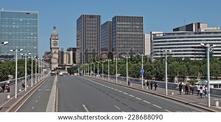 PARIS, FRANCE - JUNE 11, 2014: View from the Charles de Gaule bridge with the Bercy skyline and the gare de Lyon clock tower.