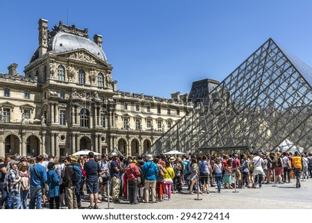 PARIS, FRANCE - JUNE 8, 2015: View of Louvre building at courtyard of Louvre Museum. Louvre Museum is one of the largest and most visited museums worldwide. - stock photo