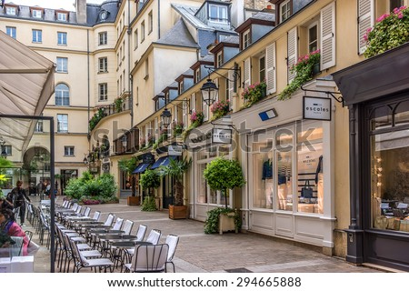 PARIS, FRANCE - JUNE 1, 2015: View of Royal Village. Royal Village located near Madeleine in 8th district. This passage (renovation 1992) is very charming and filled with luxury shops. - stock photo