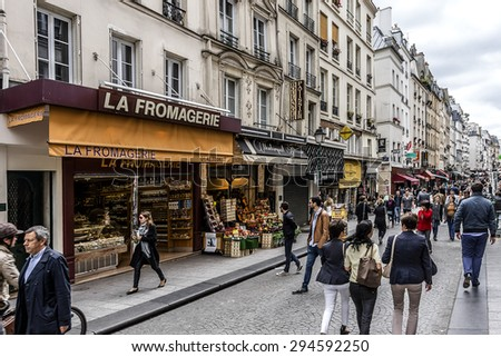 PARIS, FRANCE - JUNE 2, 2015: View of Rue Montorgueil - street in Montorgueil-Saint Denis-Les Halles district of Paris. Street is full of restaurants, cafes, bakeries, cheese shops, flower shops� - stock photo