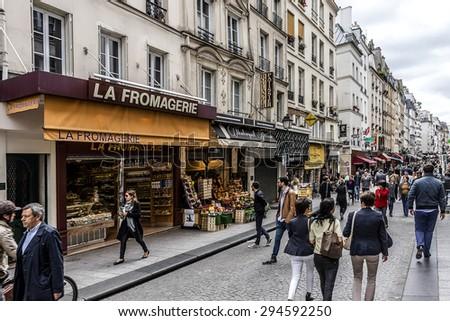 PARIS, FRANCE - JUNE 2, 2015: View of Rue Montorgueil - street in Montorgueil-Saint Denis-Les Halles district of Paris. Street is full of restaurants, cafes, bakeries, cheese shops, flower shops� - stock photo
