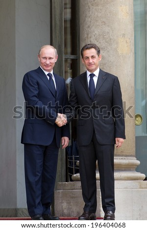 PARIS, FRANCE - JUNE 21, 2011 : Vladimir Putin and Nicolas Sarkozy, during a wokl visit at Palais de l'Elysee - stock photo