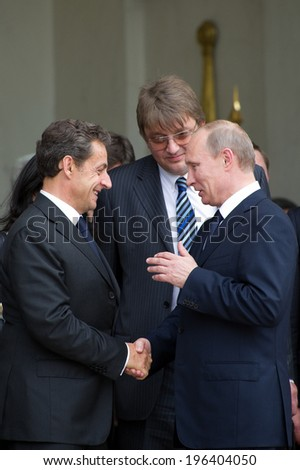 PARIS, FRANCE - JUNE 21, 2011 : Vladimir Putin and Nicolas Sarkozy, during a work visit at Palais de l'Elysee - stock photo