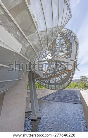 PARIS, FRANCE - MAI 12, 2015: The Louis Vuitton Foundation. The Fondation Louis Vuitton is an art museum and cultural center sponsored by the group LVMH. - stock photo