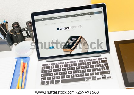PARIS, FRANCE - MAR 10, 2015: Apple Computers website on MacBook Retina in room environment showcasing  golden Apple Watch Edition as seen on 10 March, 2015 - stock photo