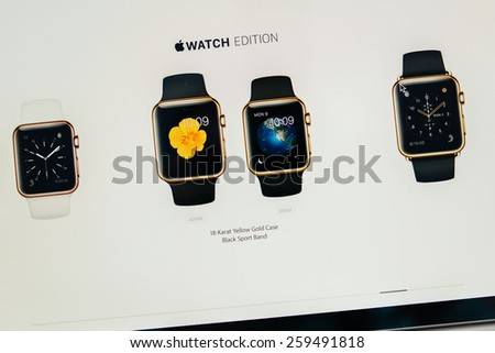 PARIS, FRANCE - MAR 10, 2015: Apple Computers website on MacBook Retina in room environment showcasing  golden Apple Watch Edition range as seen on 10 March, 2015 - stock photo