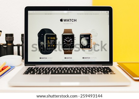 PARIS, FRANCE - MAR 10, 2015: Apple Computers website on MacBook Retina in room environment showcasing Apple Watch Range as seen on 10 March, 2015 - stock photo