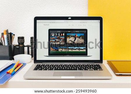 PARIS, FRANCE - MAR 10, 2015: Apple Computers website on MacBook Retina in room environment showcasing new MacBook iMovie app as seen on 10 March, 2015 - stock photo