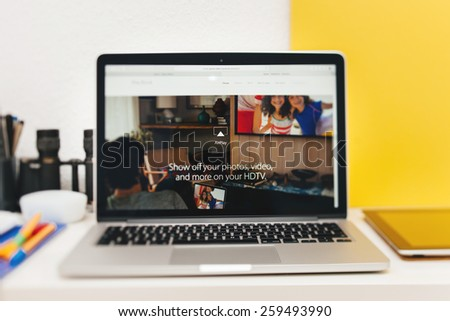 PARIS, FRANCE - MAR 10, 2015: Apple Computers website on MacBook Retina in room environment showcasing AirPlay over new MacBook  as seen on 10 March, 2015 - stock photo