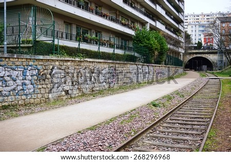 PARIS, FRANCE -10 MAR 2015- Editorial: La petite ceinture (little belt) is a decrepit railway line that circles around Paris. Some sections have been opened to pedestrians, inspiring NYC's High Line. - stock photo