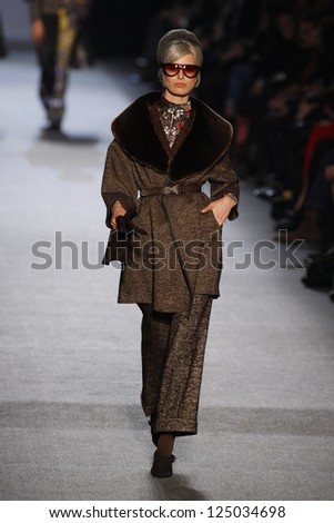 PARIS, FRANCE - MARCH 05: A model walks the runway at the Jean Paul Gaultier fashion show during Paris Fashion Week on March 5, 2011 in Paris, France.