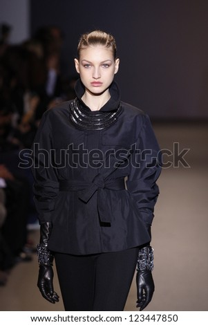 PARIS, FRANCE - MARCH 6: A model walks the runway during the Andrew GN Ready to Wear Autumn/Winter 2011/2012 show during Paris Fashion Week on March 6, 2011 in Paris, France