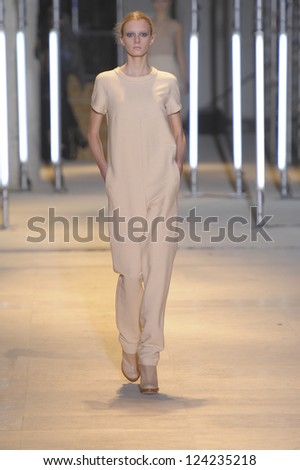 PARIS, FRANCE - MARCH 05: A model walks the runway during the Cacharel Ready to Wear Autumn/Winter 2011/2012 show during Paris Fashion Week at Palais De Tokyo on March 5, 2011 in Paris, France - stock photo