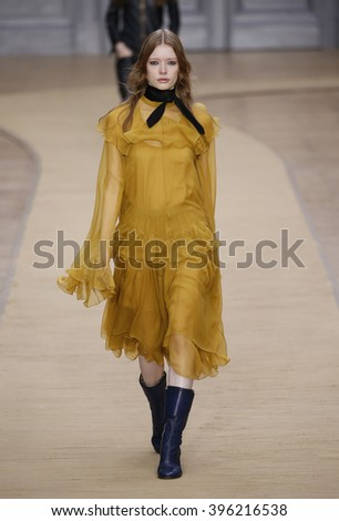 PARIS, FRANCE - MARCH 03: A model walks the runway during the Chloe show as part of the Paris Fashion Week Womenswear Fall/Winter 2016/2017 on March 3, 2016 in Paris, France. - stock photo
