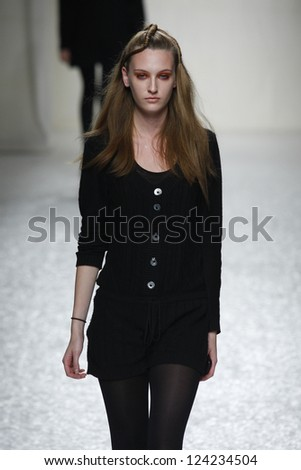 PARIS, FRANCE - MARCH 07: A model walks the runway during the Comuun Ready to Wear Autumn/Winter 2011/2012 show during Paris Fashion Week on March 7, 2011 in Paris, France