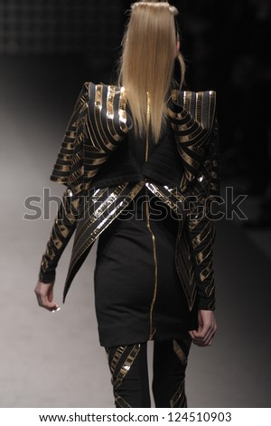 PARIS, FRANCE - MARCH 02: A model walks the runway during the Gareth Pugh Ready to Wear Fall/Winter 2011 show as part of the Paris Fashion Week on March 02, 2011