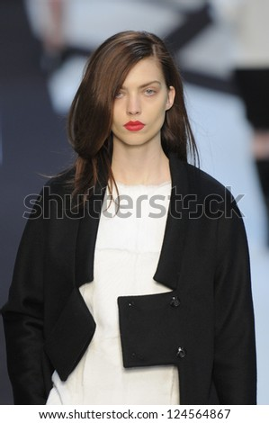 PARIS, FRANCE - MARCH 02: A model walks the runway during the Guy Laroche Ready to Wear Fall/Winter 2011 show as part of the Paris Fashion Week on March 02, 2011