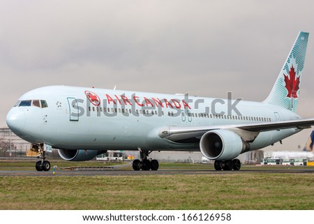 PARIS, FRANCE - MARCH 29: Air Canada Boeing 767-333/ER taxis around CDG Airport on March 29, 2010. Air Canada is the flag carrier and largest airline of Canada. - stock photo