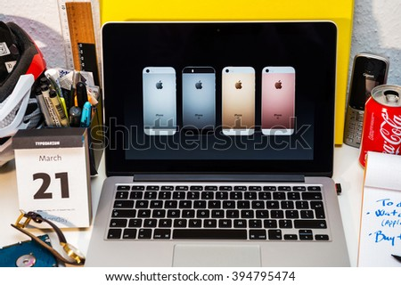 PARIS, FRANCE - MARCH 21, 2016: Apple Computers website on MacBook Pro Retina in a creative room environment showcasing Apple Event with Greg Joswiak presenting new iPhone SE colors - stock photo