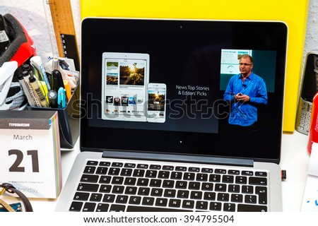 PARIS, FRANCE - MARCH 21, 2016: Apple Computers website on MacBook Pro Retina in a creative room environment showcasing Apple Event with Greg Joswiak presenting iOS 9.3 with Apple News - stock photo