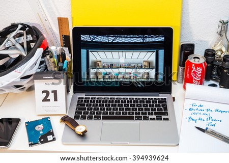 PARIS, FRANCE - MARCH 21, 2016: Apple Computers website on MacBook Pro Retina in a creative room environment showcasing Apple Event with Lisa Jackson presenting 100% renewable China store - stock photo