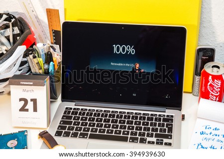 PARIS, FRANCE - MARCH 21, 2016: Apple Computers website on MacBook Pro Retina in a creative room environment showcasing Apple Event with Lisa Jackson claiming 100% renevable Apple facilities in USA - stock photo