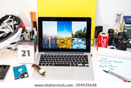 PARIS, FRANCE - MARCH 21, 2016: Apple Computers website on MacBook Pro Retina in a creative room environment showcasing Apple Event with renewable eneriges used by Apple - stock photo