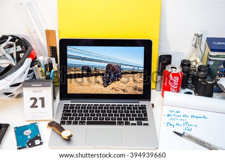 PARIS, FRANCE - MARCH 21, 2016: Apple Computers website on MacBook Pro Retina in a creative room environment showcasing Apple Event with Solar plant in China - stock photo