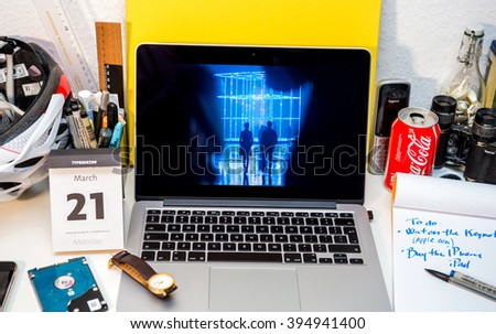 PARIS, FRANCE - MARCH 21, 2016: Apple Computers website on MacBook Pro Retina in a geek creative room environment showcasing the newly announced iPad pro and its 12Mpx camera - stock photo