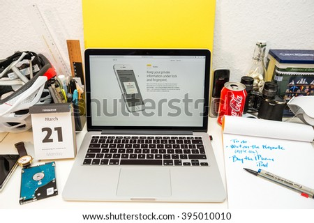 PARIS, FRANCE - MARCH 21, 2016: Apple Computers website on MacBook Pro Retina in a geek creative room environment showcasing the newly announced iOS 9.3 with secure Notes app - stock photo