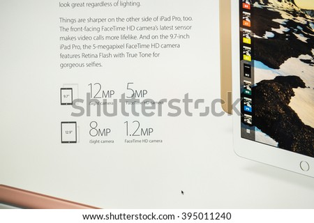 PARIS, FRANCE - MARCH 21, 2016: Apple Computers website on MacBook Pro Retina in a geek creative room environment showcasing the newly announced 12 Megapixels camera on iPad Pro - stock photo