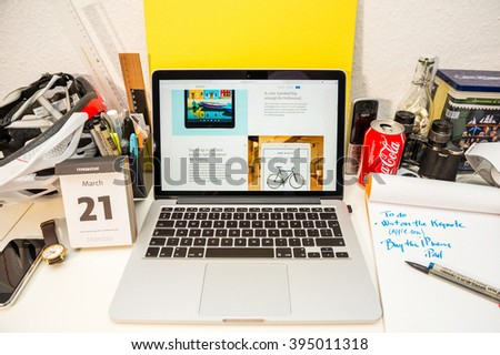 PARIS, FRANCE - MARCH 21, 2016: Apple Computers website on MacBook Pro Retina in a geek creative room environment showcasing the newly announced iPad Pro and True Tone option  - stock photo