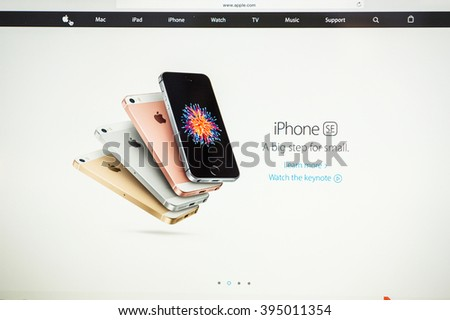 PARIS, FRANCE - MARCH 21, 2016: Apple Computers website on MacBook Pro Retina in a geek creative room environment showcasing the newly announced iPhone SE in four color variation - stock photo