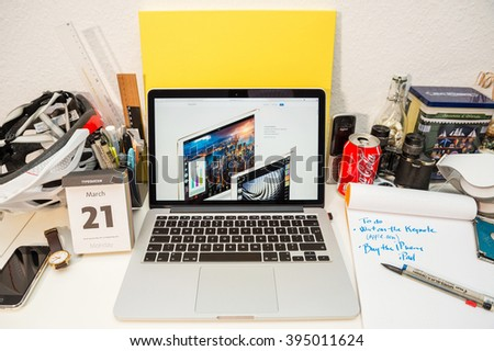 PARIS, FRANCE - MARCH 21, 2016: Apple Computers website on MacBook Pro Retina in a geek creative room environment showcasing the newly announced small iPad Pro - stock photo