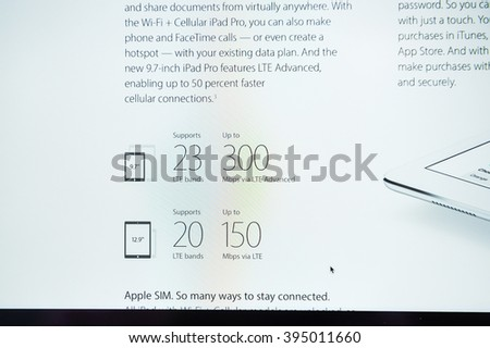 PARIS, FRANCE - MARCH 21, 2016: Apple Computers website on MacBook Pro Retina in a geek creative room environment showcasing the newly announced iPAd pro with 300 MBS via LTE - stock photo