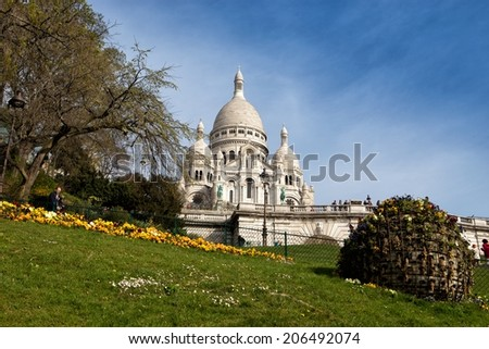 PARIS, FRANCE - MARCH 29: Basilica Sacre Coeur on March 29, 2014 in Paris. A popular landmark, the basilica is located at the summit of the butte Montmartre, the highest point in the city.