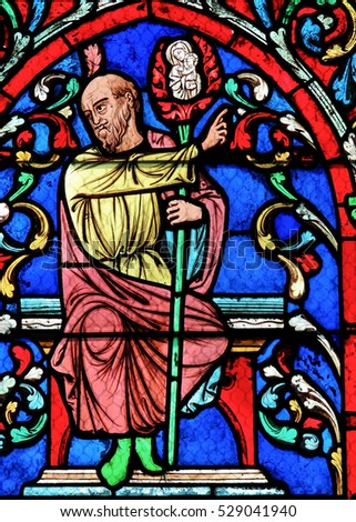 PARIS, FRANCE - MARCH 4, 2011: Detail of Tree of Jesse on 19th Century Stained Glass window in Notre Dame Cathedral of Paris, France.
