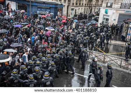 Paris, FRANCE - MARCH 31, 2016 : French police (anti-riot squad) try to control students during the demonstration against the El Khomri working law (labor law reforms).