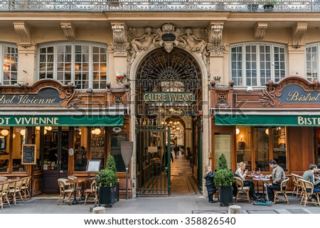 PARIS, FRANCE - MARCH 8, 2015: Galerie Vivienne (1823). Vivienne Covered Passage is 176 meters long, with shops, restaurants and tourist attraction. - stock photo