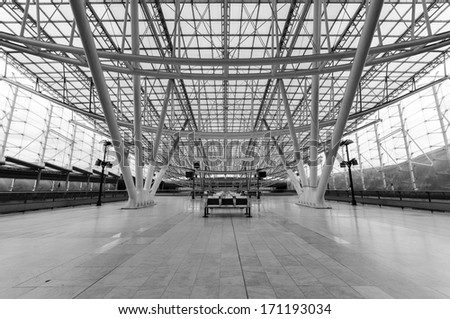 Paris, France - March 10: Interior of Charles De Gaulle TGV Airport Train Station that connects to downtown including Gare De Nord or other cities in Black & White on March 10, 2011 in Paris France. - stock photo
